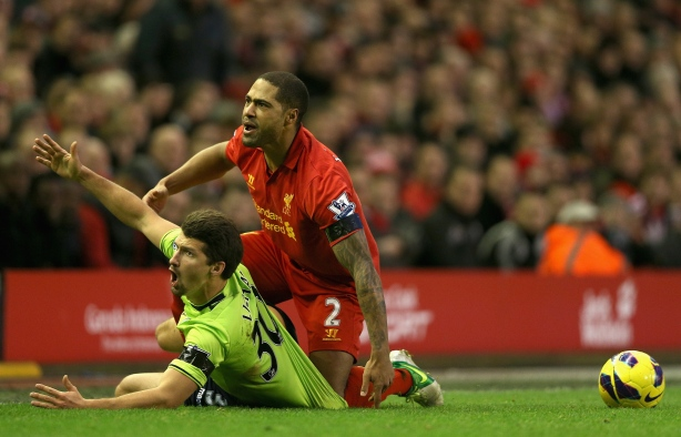 Glen Johnson frantically tries to rescue Eric Lichaj from being sucked into the turf.